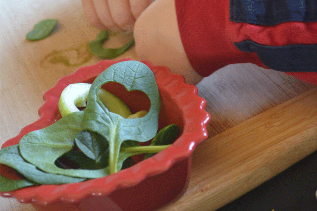 Kids making their own heart shapes for a salad!