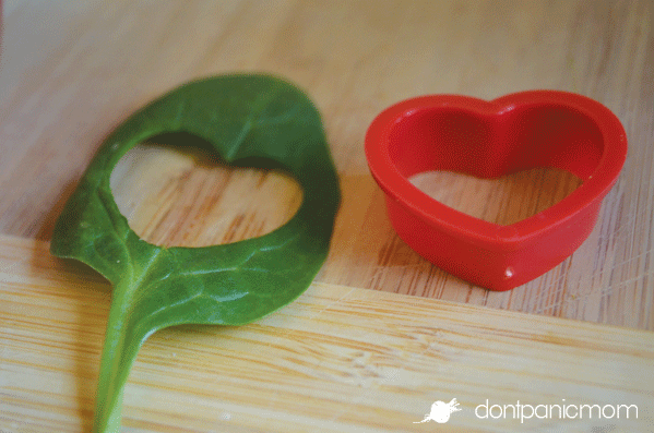 Cute addition on the top of a spinach strawberry salad!