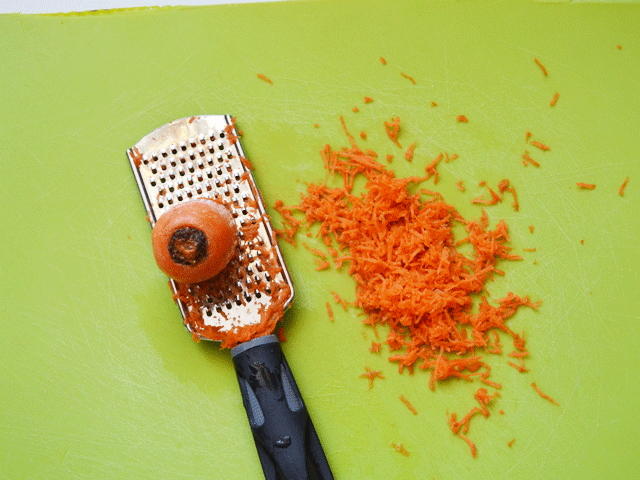 Finely Grate Carrots and call them SPRINKLES! Let your kiddos sprinkle them on bagels, pizza, or sandwiches.